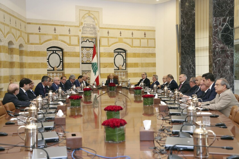 In this photo released by the Lebanese Government, Lebanese President Michel Aoun, center, meets with several Cabinet ministers and top banking officials, at the Presidential Palace in Baabda, east of Beirut, Lebanon, Saturday, Nov. 9, 2019, in search for solutions for the deepening financial and economic crisis. (Dalati Nohra/Lebanese Government via AP)
