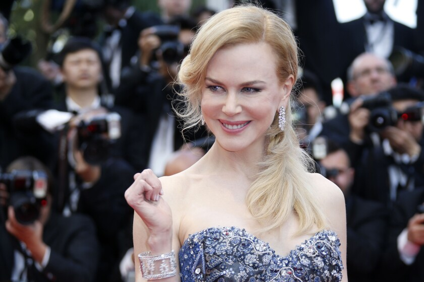 """Australian actress Nicole Kidman poses as she arrives for the opening ceremony and the screening of her film """"Grace of Monaco."""""""