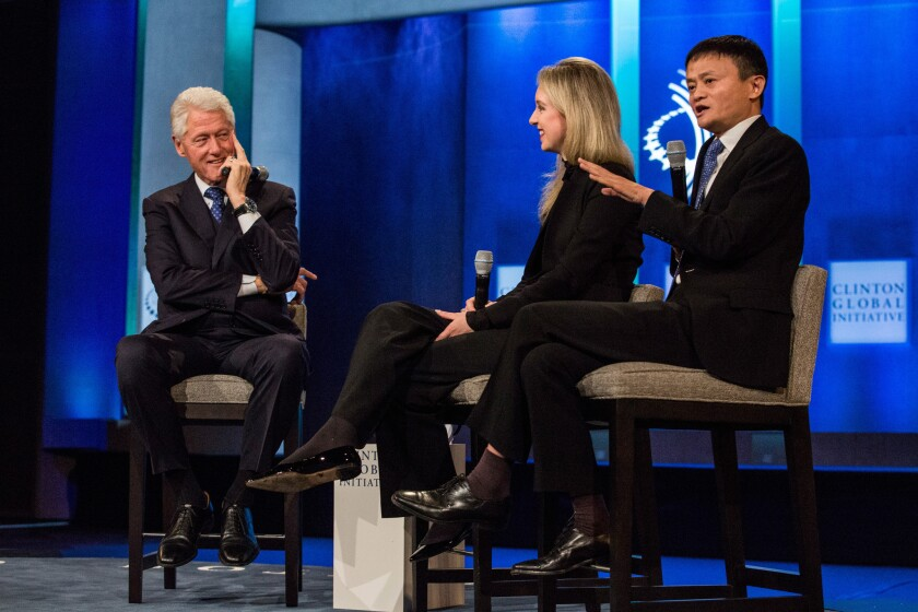 Put the excitement on hold for a moment: Elizabeth Holmes of beleaguered startup Theranos was flanked by former President Bill Clinton and Jack Ma, chairman of Alibaba Group, at a recent event sponsored by the Clinton Global Initiative.