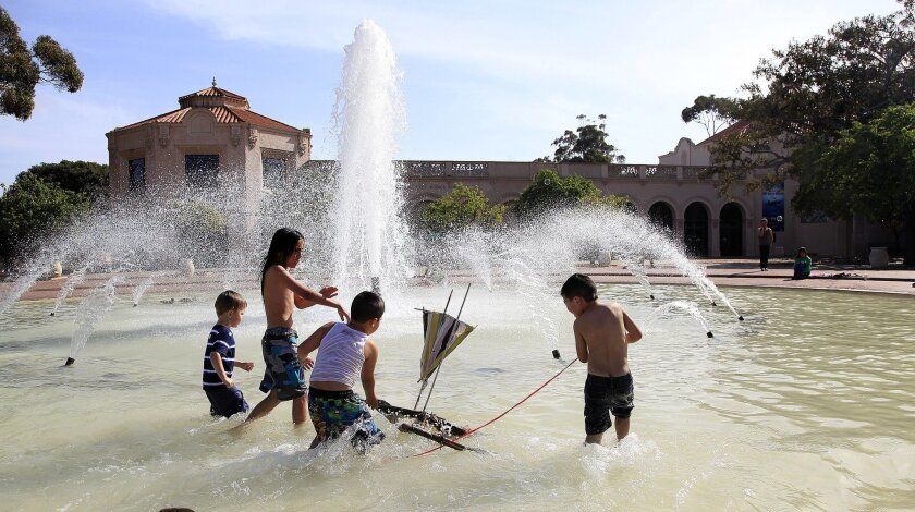 Children used the temperate almost-Spring weather to wade in the Bea Evenson Fountain in Balboa Park  with small Vinta boats handmade by local Filipino artist Guillermo Buenaflor.