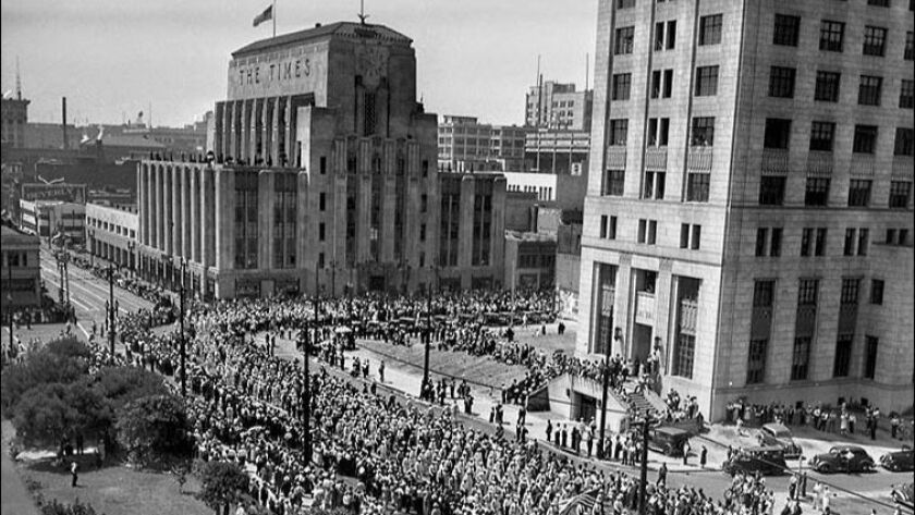 Sept. 6, 1937: About 50,000 workers marched in the Labor Day parade in downtown L.A. In this photo, the old L.A. Times Building is on the left and now-demolished State Building is seen on the right.