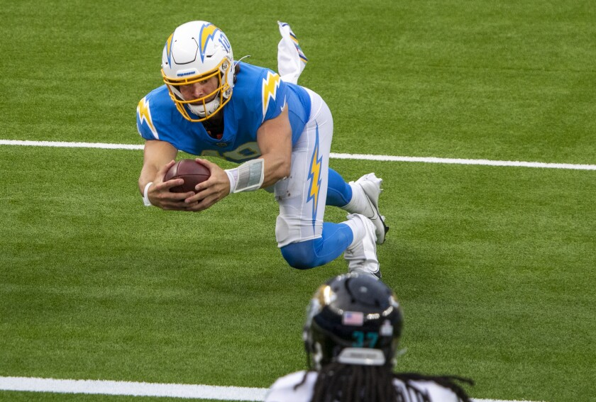 Chargers quarterback Justin Herbert dives forward for a third-quarter touchdown against the Jacksonville Jaguars.
