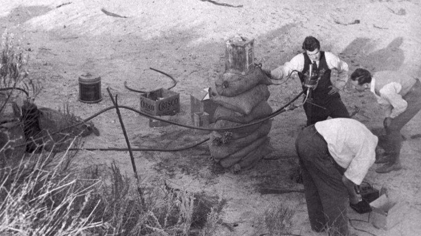 One of the first rocket motor tests in Arroyo Seco near JPL in 1936. A group of Caltech students and local rocket enthusiasts gathered there to do a series of tests.