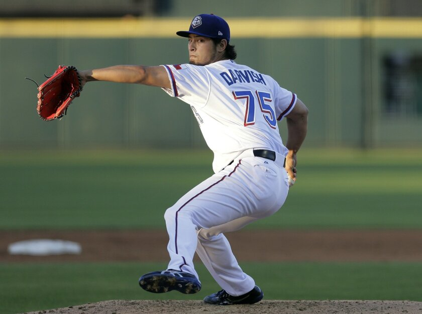FILE- In this May 6, 2016, file photo, Texas Rangers pitcher Yu Darvish delivers during a rehab start for Triple-A Round Rock Express against the New Orleans Zephyrs during a baseball game, Friday, May 6, 2016, in Austin, Texas. Darvish missed the end of the 2014 season with right elbow inflammatio