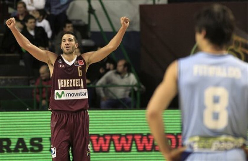 Venezuela's Greivis Vasquez, left, celebrates his team's win over Uruguay during a FIBA Americas Championship basketball game in Mar del Plata, Argentina, Thursday Sept. 8, 2011. The top two finishers of the tournament get an automatic berth in the 2012 London Olympics and the next three advance to the last-chance Olympic qualifier to be held in July 2012. Venezuela won 92-80. (AP Photo/Martin Mejia)