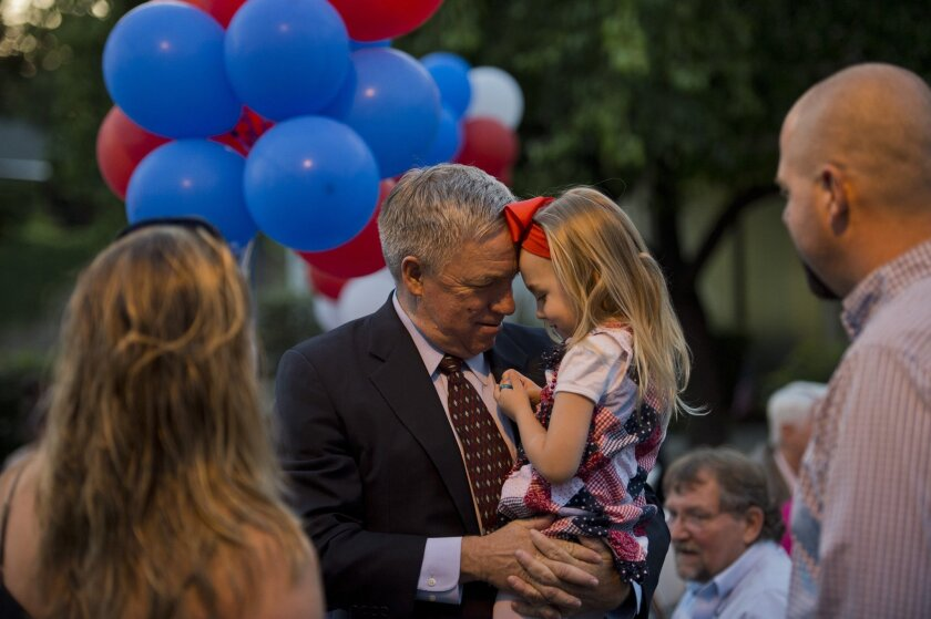 Doug Ose Republican candidate for U.S. Representative of California's 7th Congressional District has a quiet moment with his great niece Lillian Astle, 3 1/2, at campaign headquarters on Tuesday June 3, 2014 in Fair Oaks, Calif. (AP Photo/The Sacramento Bee, Renee C. Byer)