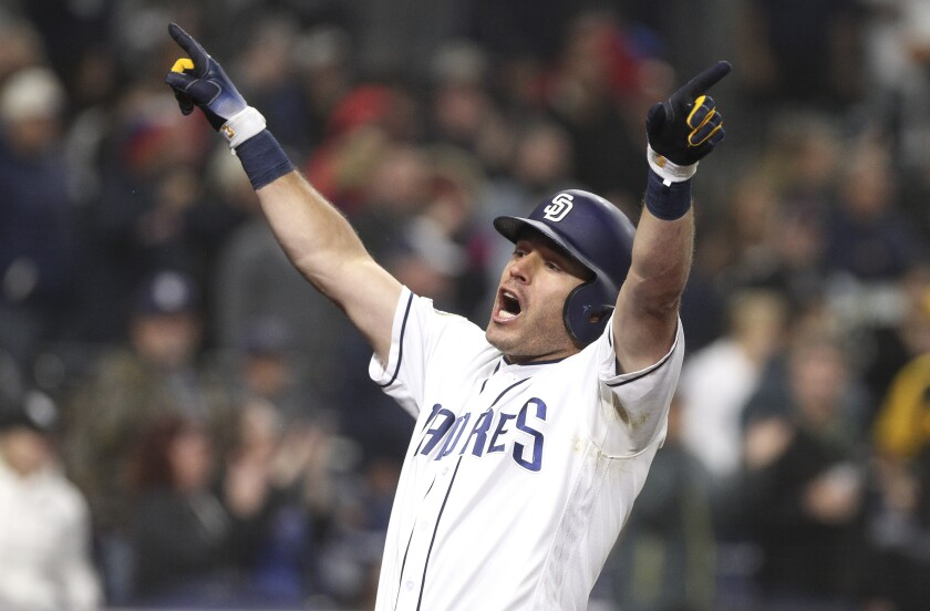 The Padres' Ian Kinsler lets out a yell as he celebrates his three-run home run in the sixth inning against the Pirates at Petco Park on Thursday.