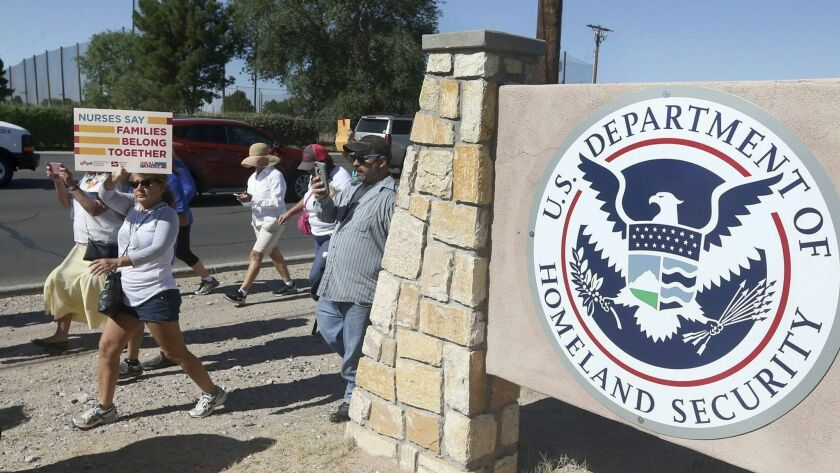 File-This June 2018, file photo shows protesters walking along Montana Avenue outside the El Paso Pr