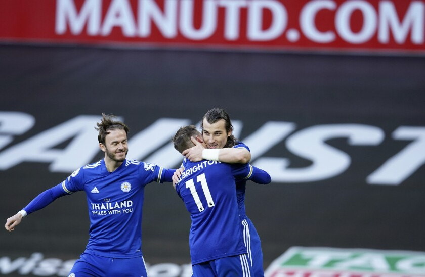 Leicester's Caglar Soyuncu, center, celebrates with teammates after scoring his side's second goal during the English Premier League soccer match between Manchester United and Leicester City, at the Old Trafford stadium in Manchester, England, Tuesday, May 11, 2021. (AP Photo/Dave Thompson, Pool)