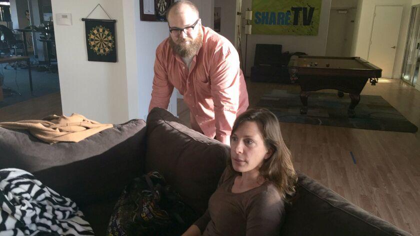 Vinny Green and Brooke Binkowski in the Pacific Beach office of Proper Media.
