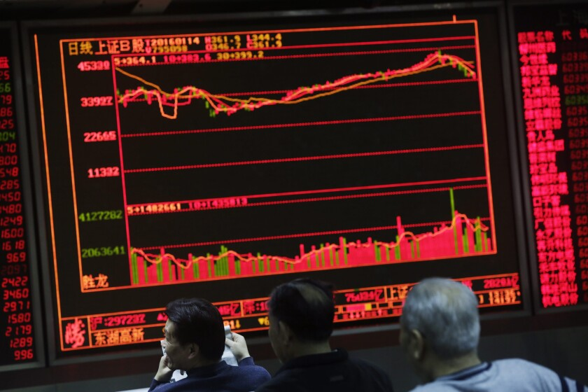 Chinese investors follow the market at a securities brokerage house in Beijing.
