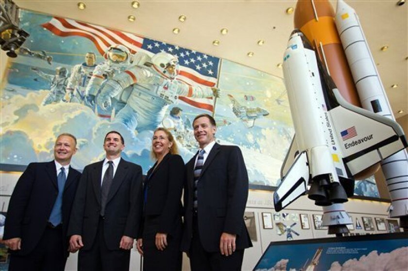 In this June 30, 2011 photo, the crew of STS-135, from left, pilot Doug Hurley, commander Chris Ferguson, mission specialist Sandy Magnus and mission specialist Rex Walheim pose for a group photo following the crew media briefing at the Johnson Space Center, in Houston. The news briefing provided the last scheduled opportunity for a large group of media to speak with the space shuttle Atlantis crew before the final launch on July 8. (AP Photo/Houston Chronicle, Smiley N. Pool) MANDATORY CREDIT