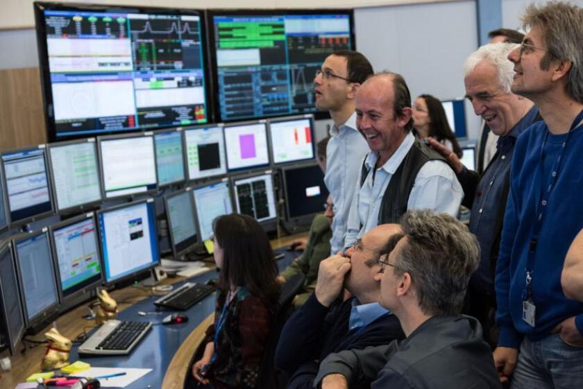 Scientists with the Large Hadron Collider watch as first beam of protons passes rapidly through the ring-shaped particle accelerator.