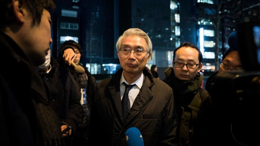 Junichiro Hironaka, a new lawyer for former Nissan chief Carlos Ghosn, speaks with media outside his offices in Tokyo.