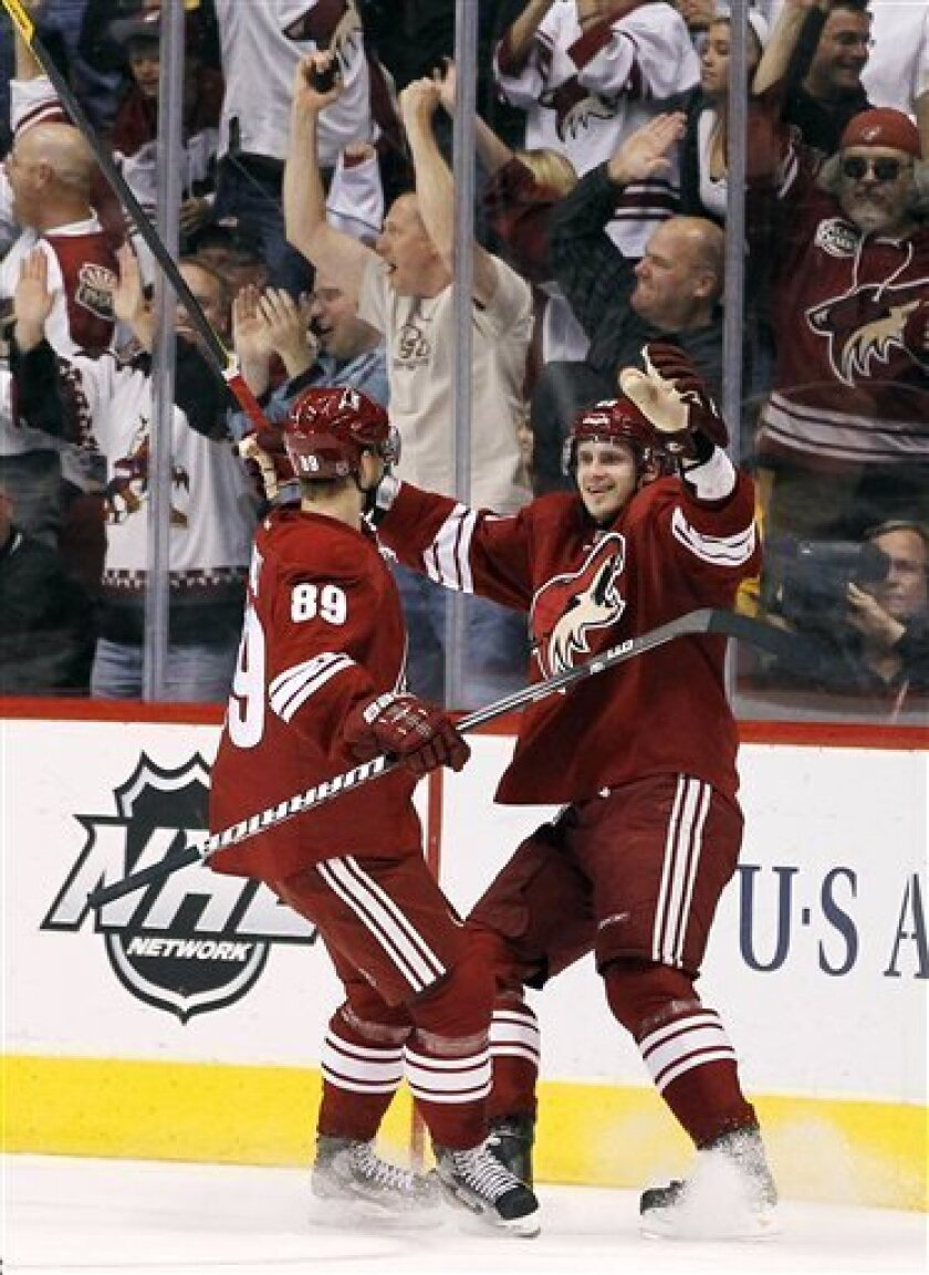 Phoenix Coyotes' Oliver Ekman-Larsson, right, of Sweden, celebrates his goal against the Anaheim Ducks with Mikkel Boedker (89), of Denmark, during the first period in an NHL hockey game, Saturday, March 31, 2012, in Glendale, Ariz. (AP Photo/Ross D. Franklin)