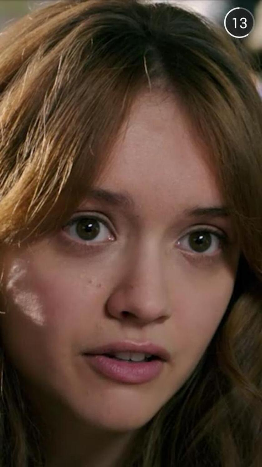 """Actress Olivia Cooke is seen a trailer for the movie """"Ouija"""" that users on Snapchat had a chance to voluntarily watch last weekend."""