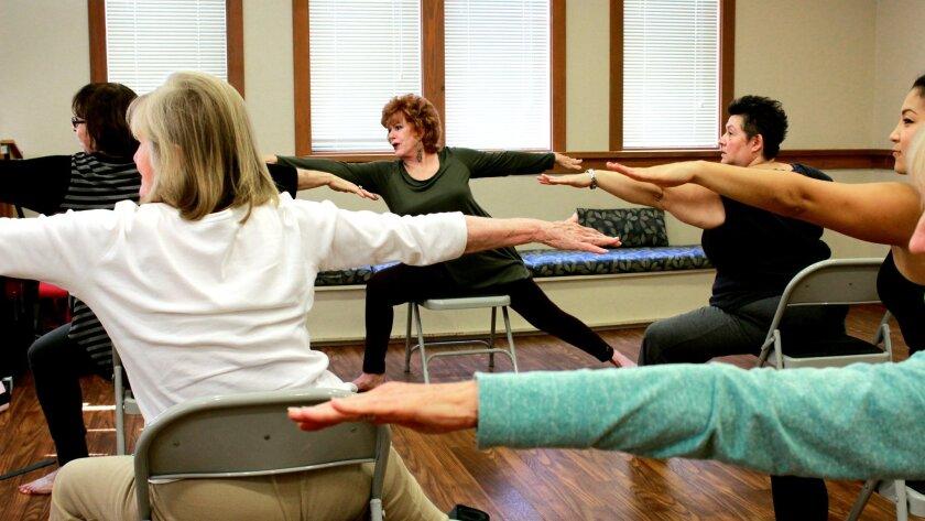 Dr. Ann Clark teaching chair yoga.