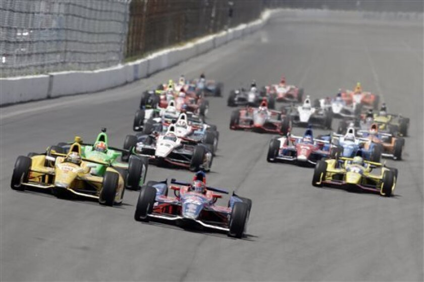 Marco Andretti (25) leads the field down the front stretch after taking the green flag to start the Pocono IndyCar 400 auto race, Sunday, July 7, 2013, in Long Pond, Pa. (AP Photo/Mel Evans)