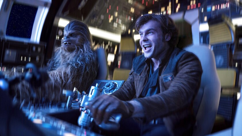 In this image released by Lucasfilm, Alden Ehrenreich, right, and Joonas Suotamo appear in a scene f
