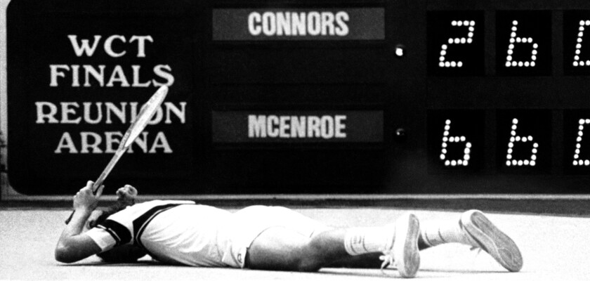 Tennis star John McEnroe lies face down on the court after missing a volley in Dallas in 1980.