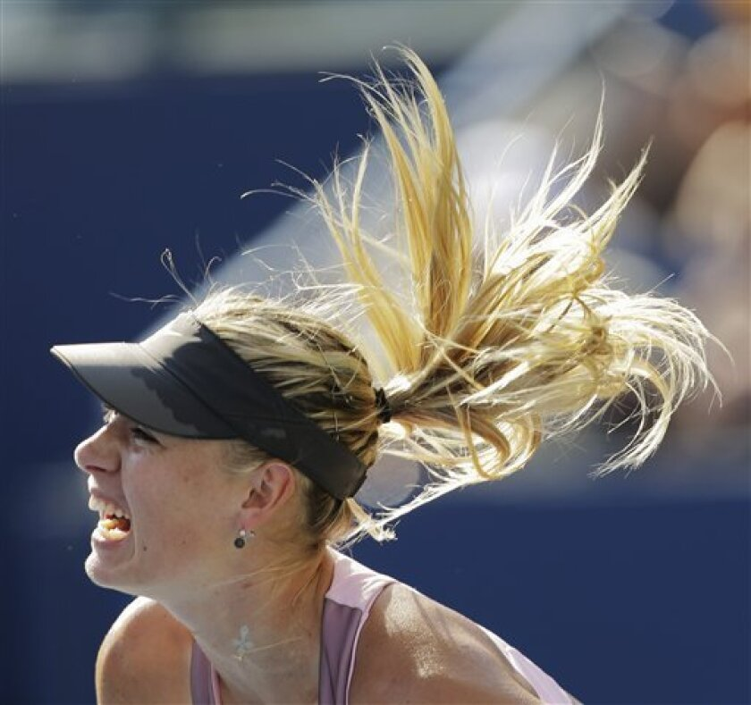 Maria Sharapova, of Russia, serves to Mallory Burdette in the third round of play at the 2012 US Open tennis tournament,  Friday, Aug. 31, 2012, in New York. (AP Photo/Mike Groll)