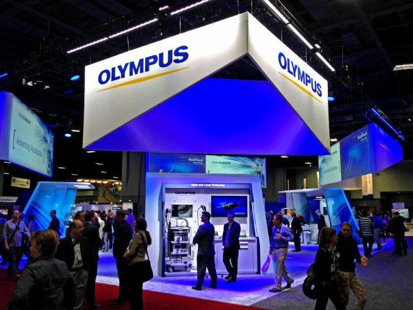 Olympus Corp. makes a specialty endoscope tied to superbug outbreaks at U.S. hospitals. Above, the company's exhibit at a Washington medical conference last year.