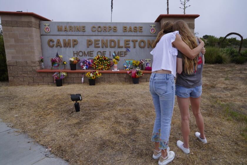 Ericka Beck comforts her daughter Cara Steffens
