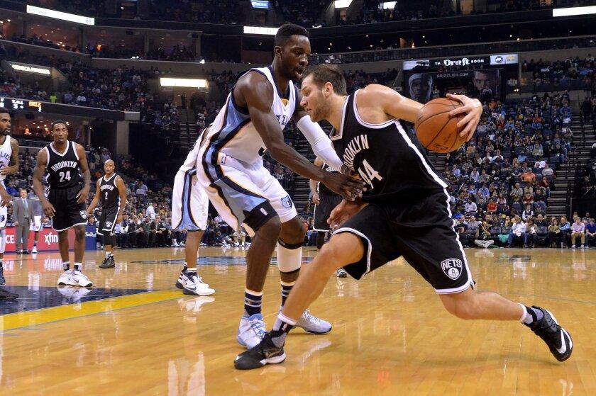 Brooklyn Nets guard Bojan Bogdanovic (44) controls the ball against Memphis Grizzlies forward Jeff Green, left, in the first half of an NBA basketball game Saturday, Oct. 31, 2015, in Memphis, Tenn. (AP Photo/Brandon Dill)