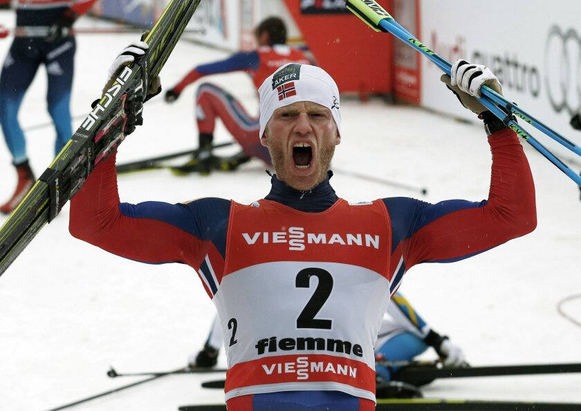 FILE - In this Sunday, Jan. 11, 2015 file photo, Norway's Martin Johnsrud Sundby celebrates at the end of a Tour de Ski, men's 9-kilometer cross-country ski event in Val di Fiemme, northern Italy. Norwegian cross-country skier Martin Johnsrud Sundby is losing his 2015 overall World Cup and Tour de
