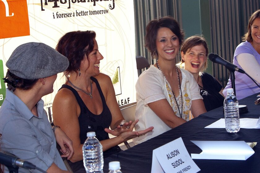 Sarah McLachlan (second from left) is shown in San Diego at a press conference prior to the 2010 Lilith Fair festival show here.  San Diego singer-songwriter Ashley Matte is seated in the center, immediately to McLachlan's right.
