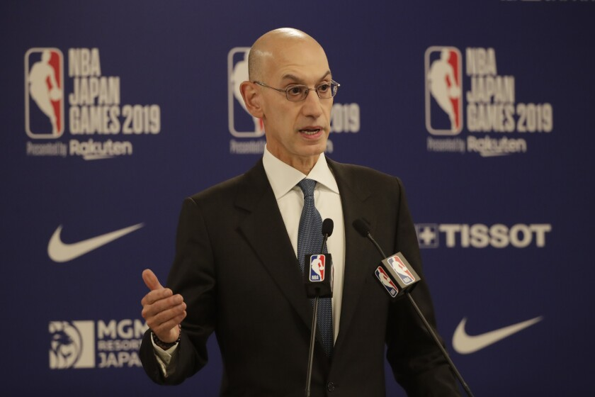 NBA Commissioner Adam Silver speaks at a news conference.