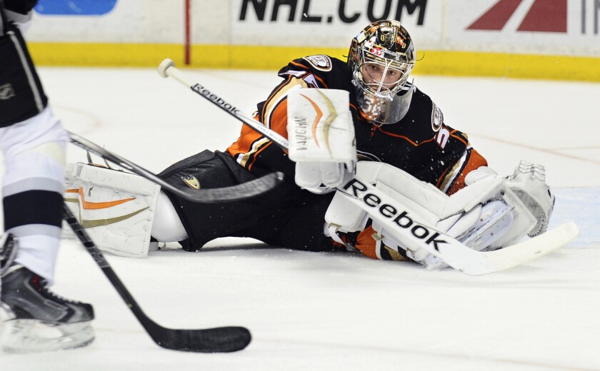 Ducks goaltender John Gibson makes a save on a shot by Kings right wing Justin Williams in the second period Friday night at Honda Center.