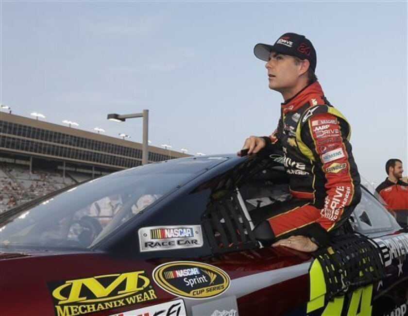 Sprint Cup Series driver Jeff Gordon (24) climbs out of his car after qualifying for Sunday's Advocare 500 NASCAR auto race at Atlanta Motor Speedway in Hampton, Ga., Friday, Aug. 30, 2013. (AP Photo/John Bazemore)