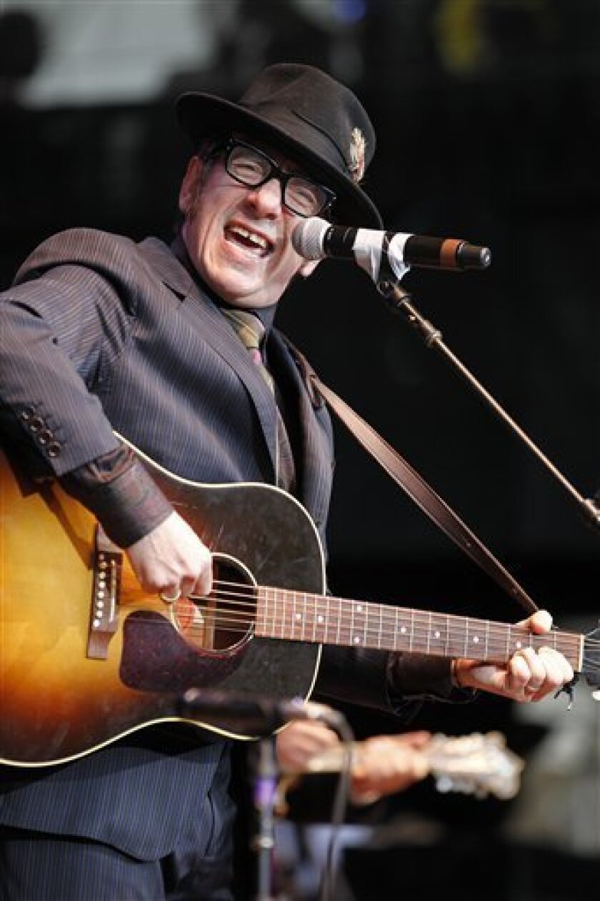 FILE - In this Oct. 24, 2010 file photo, Elvis Costello performs during the Bridge School Benefit concert in Mountain View, Calif. (AP Photo/Tony Avelar, file)