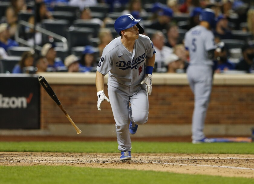Dodgers' Will Smith tosses his bat after hitting a solo home run against the New York Mets.