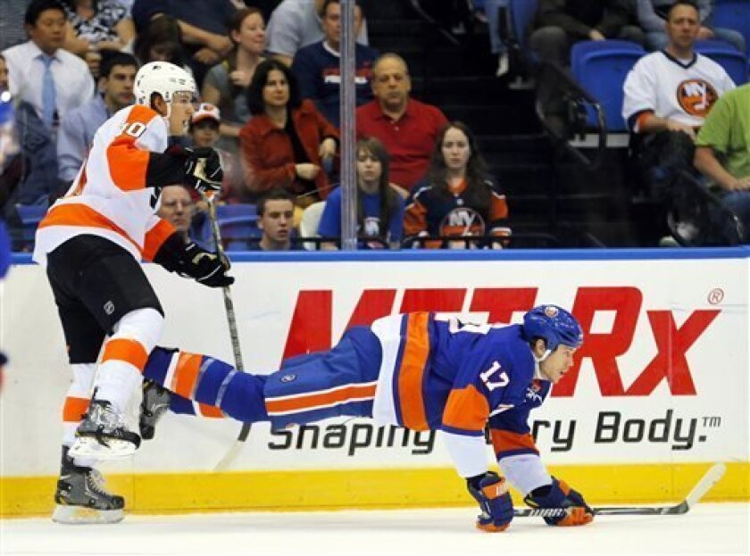 Philadelphia Flyers center Brayden Schenn (10) upends New York Islanders left wing Matt Martin (17) during the first period of an NHL hockey game at the Nassau Coliseum in Uniondale, N.Y., Tuesday, April 9, 2013. (AP Photo/Paul J. Bereswill)