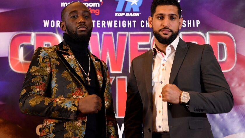 Terence Crawford, left, and Amir Khan at a news conference on Jan. 15 in London.