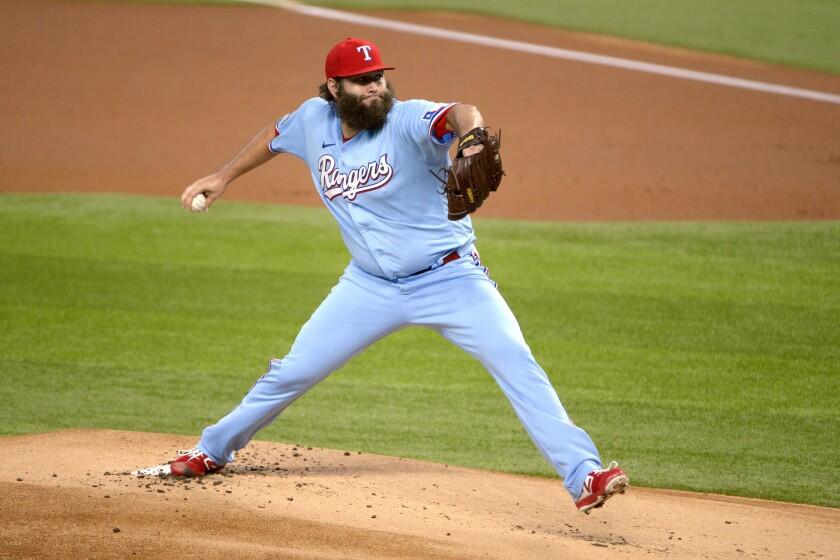 Texas Rangers starting pitcher Lance Lynn throws in the first inning during a baseball game against the Oakland Athletics, in Arlington, Tex, Sunday, Sept. 13, 2020. (AP Photo/Matt Strasten)
