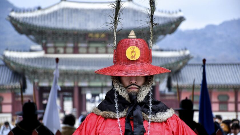 Twice daily, crowds gather for the changing of the guard at Gwanghwamun Gate of Gyeongbokgung Palace, Seoul. If that mustache looks fake, it's because it is. The guards are actors