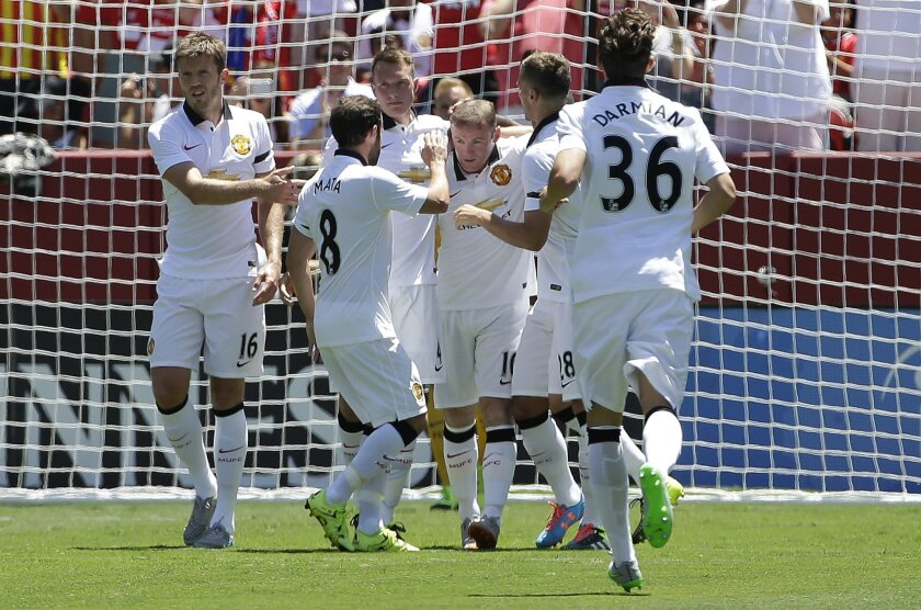 Manchester United's Wayne Rooney, center, celebrates with teammates after scoring a goal against FC Barcelona during the first half of an International Champions Cup soccer match in Santa Clara, Calif., Saturday, July 25, 2015. (AP Photo/Jeff Chiu)