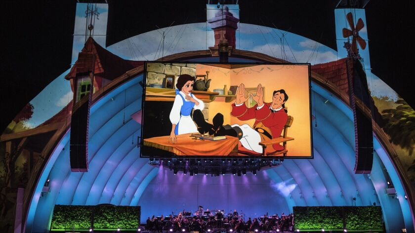 """The Disney movie """"Beauty and the Beast"""" plays on the big screen accompanied by a live orchestra duri"""