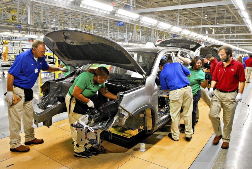 Workers assemble a 2011 Kia Sorento in a Kia automobile manufacturing facility in West Point, Ga.