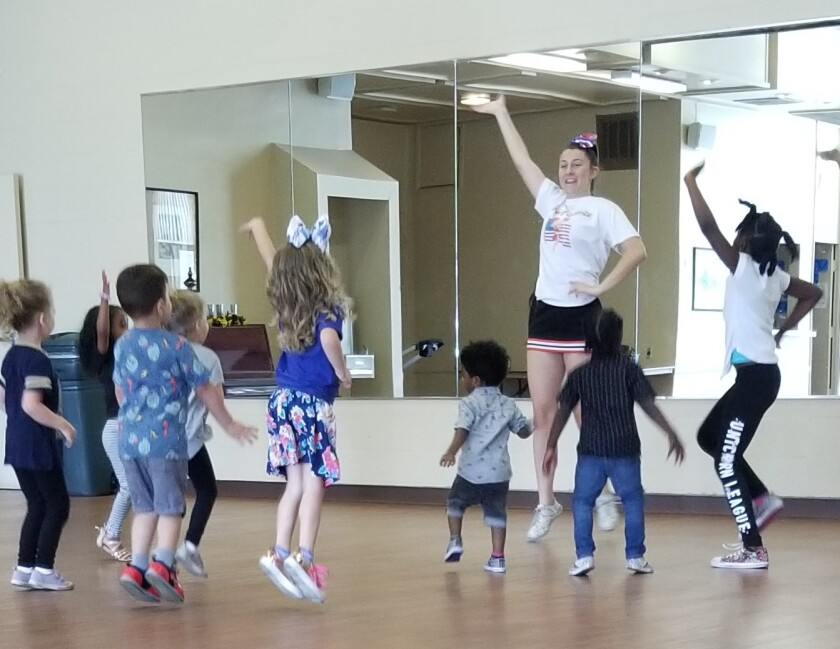Alexandra Hill instructs her cheerleading students at the North Seal Beach Community Center as part of her Gold Award project.