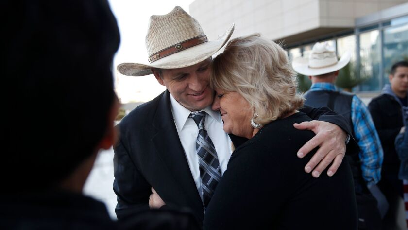 Ammon Bundy, left, hugs his aunt Lillie Spencer outside a federal courthouse in Las Vegas after a judge declared a mistrial in the case against him.