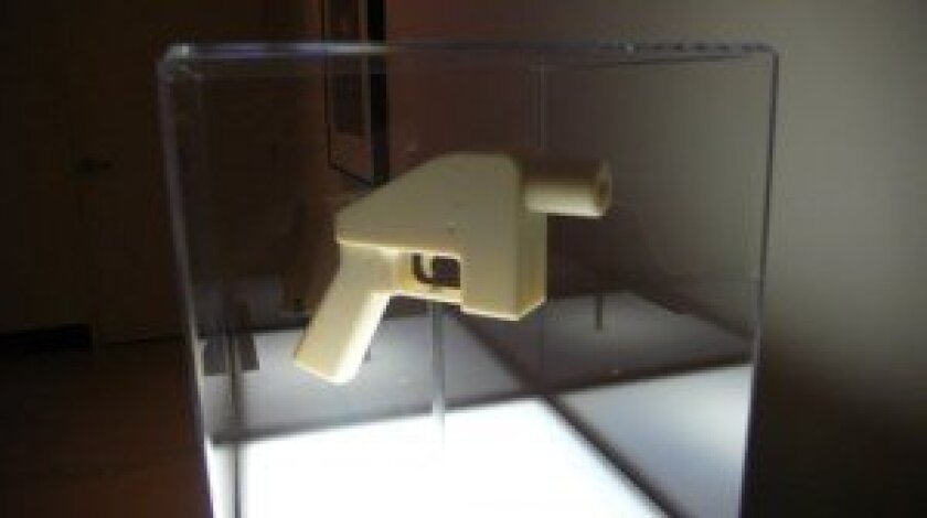 Gun made by a 3D printer at Calit2 gallery. Photos by Will Bowen.