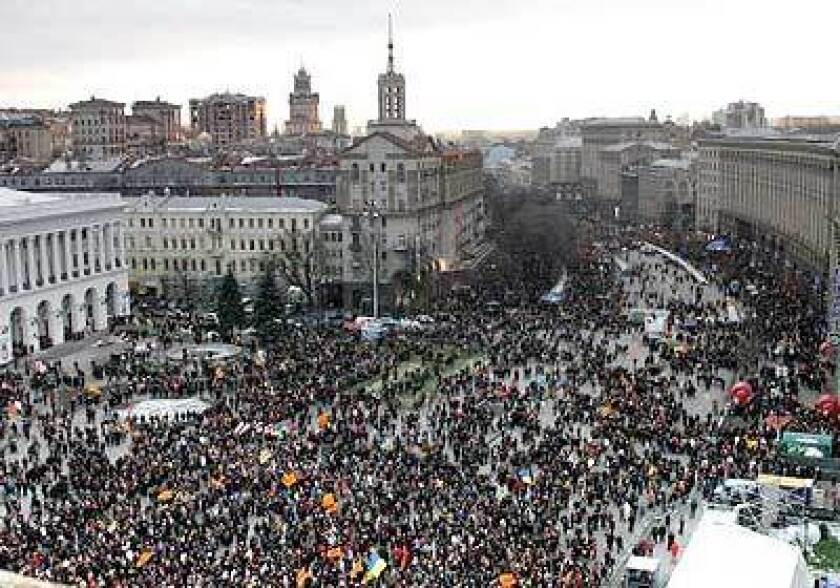 Thousands of supporters of the Western-leaning presidential candidate Viktor Yushchenko gather in Independence Square in Kiev to call for a fair count of the runoff election vote.