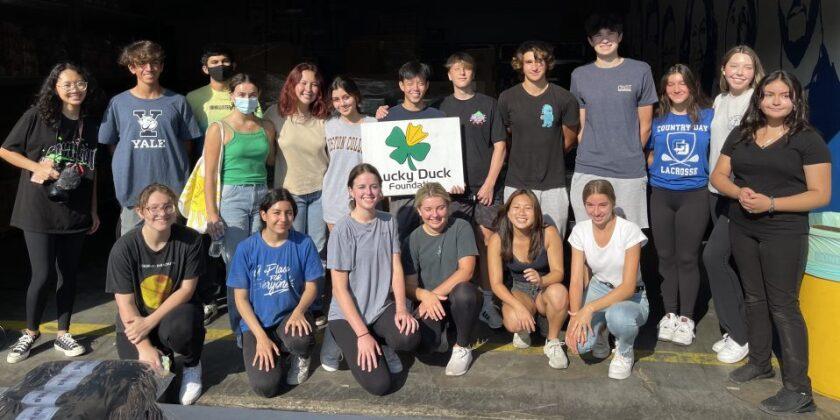 Volunteers in the Lucky Ducklings program help homeless community members.