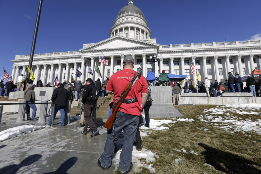 A man carries his weapon during a gun rally at  Feb. 8, 2020, in Salt Lake City.