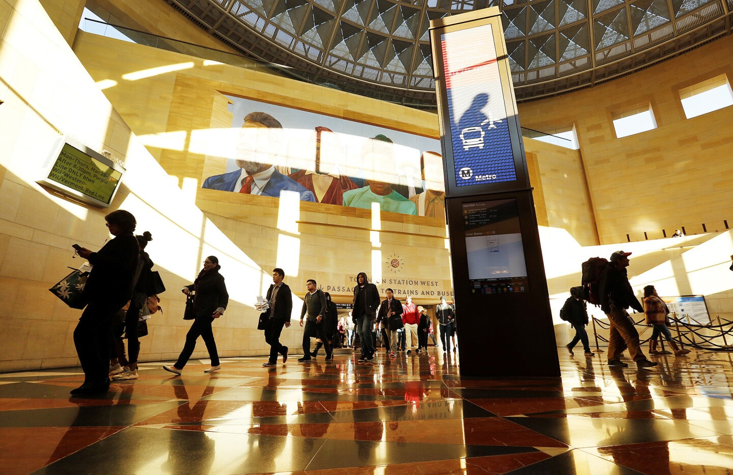 Passengers pass the new information kiosk in the Patsaouras Transit Plaza at historic Union Station, which officials hope to expand from a transit hub to more of an urban destination.