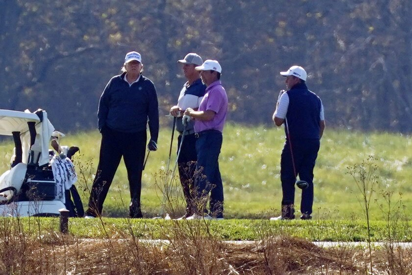 President Trump, left, golfs with others in Sterling, Va., on Nov. 7.